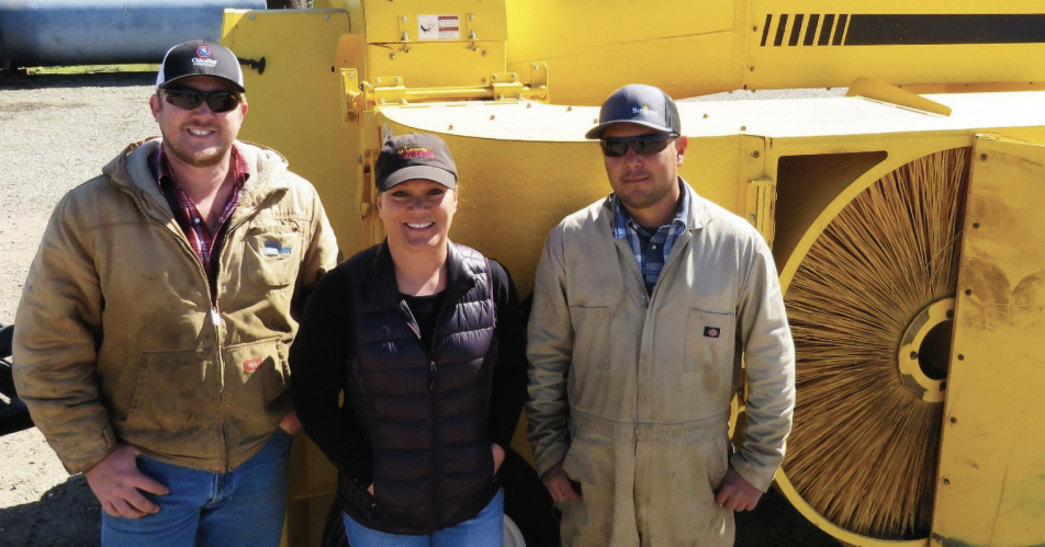 Pitts (center) and field supervisors Ben Tickenoff (left) and Javier Maldonado (right) stand with their new low-dust harvester.